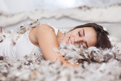 woman sleeping on feather mattress topper